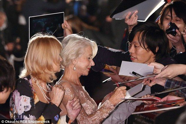 In demand: The star made sure all her fans got an autograph during the glittering evening...