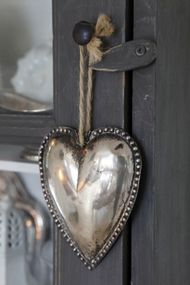 Thinking this may be a silver plated heart.... but putting it with -Pewter :)