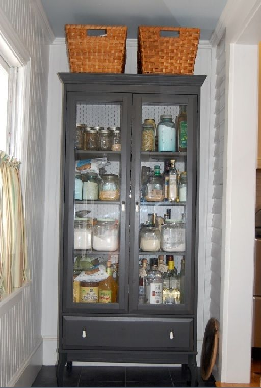 Pantry Conversion - idea for repurposing an old gun cabinet - (via chateauandbungalow)