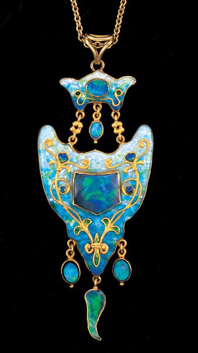 JAMES CROMAR WATT 1862-1940 Arts & Crafts Pendant Gold Enamel Opal H: 8 cm (3.15 in) W: 3 cm (1.18 in) Marks: Signed verso: 'JCW' monogram Scottish, c.1905