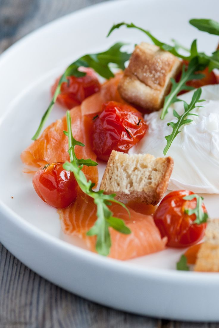 Adam Gray's twist on a breakfast classic is easy to prepare, so even the kids could help to rustle it up for a morning treat. Sweet, roasted tomatoes, crunchy muffin croutons and a scattering of peppery rocket are the perfect additions to this smoked salmon and poached eggs recipe