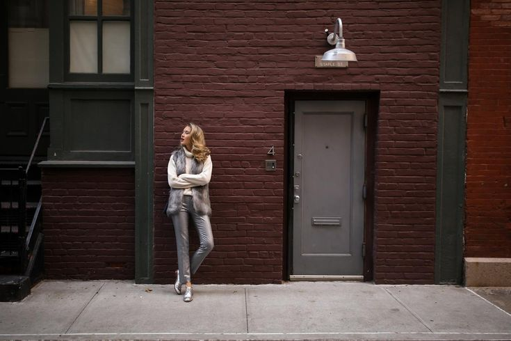 NYC fashion blogger wearing metallic silver ankle crop pants silver oxford shoes shearling vest and cream turtleneck sweater