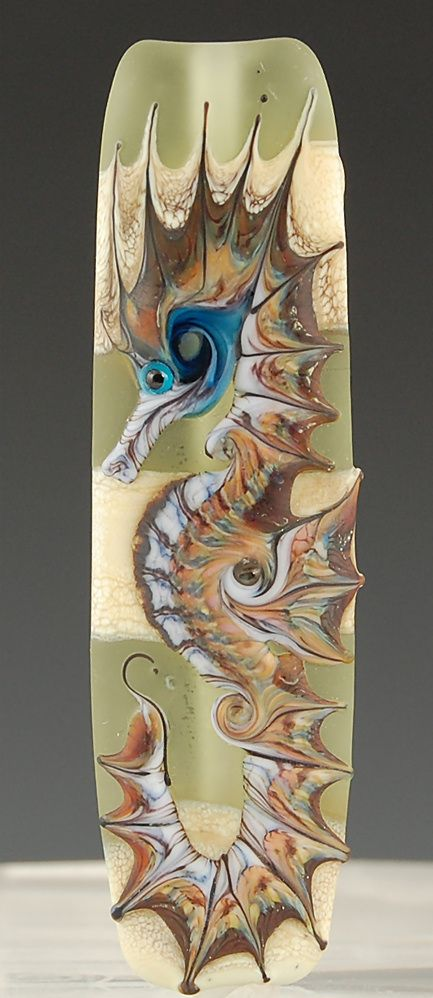 One of Kim Affleck's wonderful lampwork seahorse beads http://www.kimberlyaffleck.com/images/lg_stoney.jpg