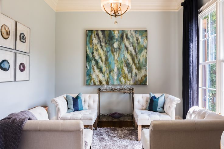 Serene and thoughtful sitting area that really focuses on the art. How gorgeous are these symmetric chairs? Design by Lauren Burns Interiors. Photo ©@catnguyenphoto.