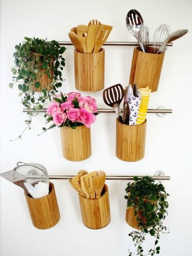 These lovely wooden canisters combine storage with decor.