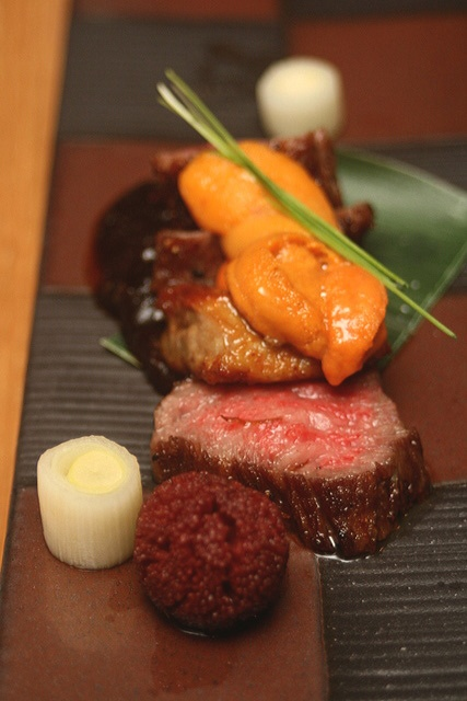 """This is intense! """"Grade A5 Hida Wagyu Beef with Foie Gras topped with Sea Urchin served on Homemade Grilled Miso""""."""