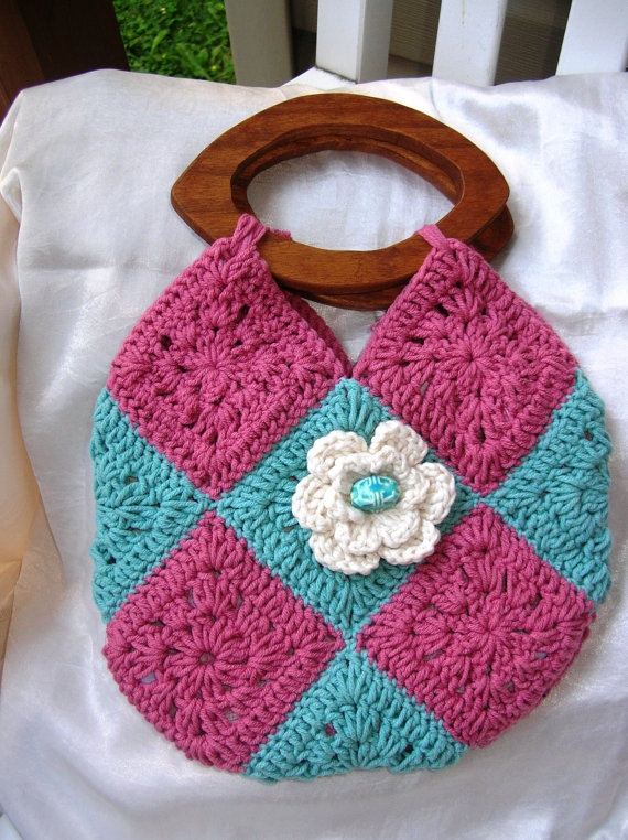 Crochet purse with wooden handles and a flower by Vanidossa, $20.00