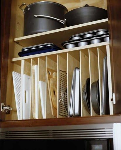 great way to organize pots and pans...i hate how my muffin pans and cookie sheets slide around all over each other under my oven every time i open the drawer...: