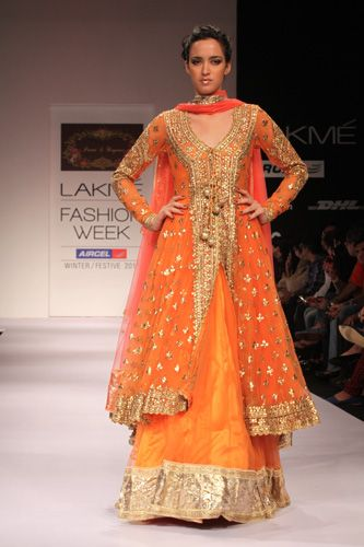 Long Orange & Gold Embellished Lengha. I love the idea of the shirt open in the front (kind of what I did at my mehndi) Or tie it to the side asian style... plain lehnga underneath. This orange would look amazing on you.