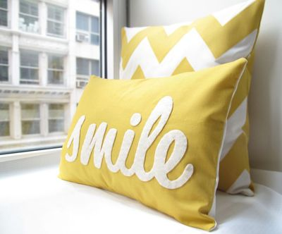 Use Cricut to cut out letters (in felt?) and then sew onto a pillow cover - great for holiday pillows!!