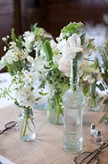 white flowers, mismatched vases