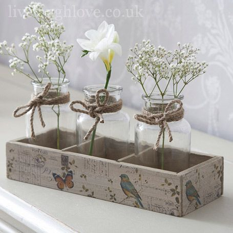 Simple, but such a pretty display of a rustic wooden tray with jars filled with simple floral arrangements, tied with twine!