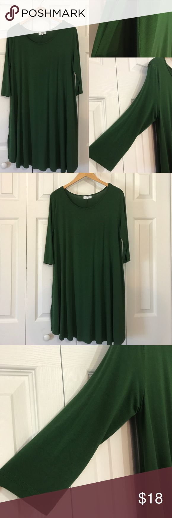 """Dress or Tunic 32""""L dress or tunic (depending in styling preferences) in hunter green color. Three fourth quarter sleeves with side pockets. 95% bamboo and 5% spandex. Piko Dresses Mini"""