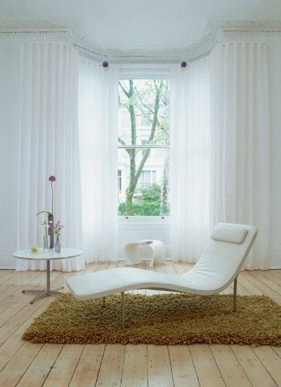 Grand White Interiors with White window Sheers  and Brown Rug