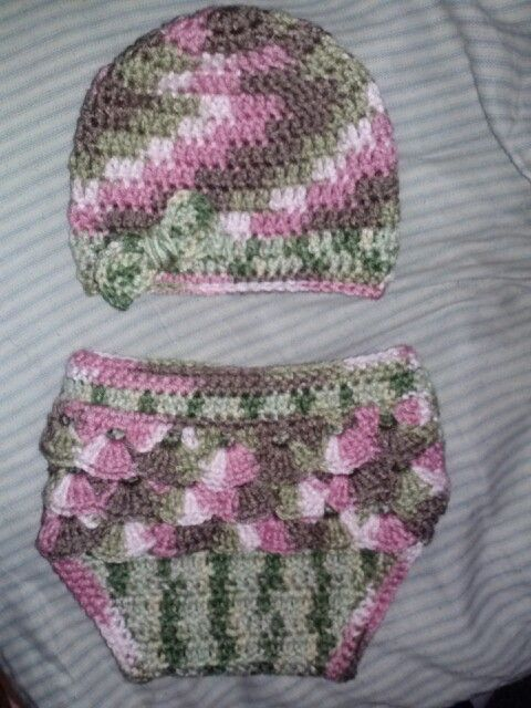 Handmade newborn girls pink/green camo ruffled diaper set. Available for purchase now at facebook.com/lilnemoknitsandthings