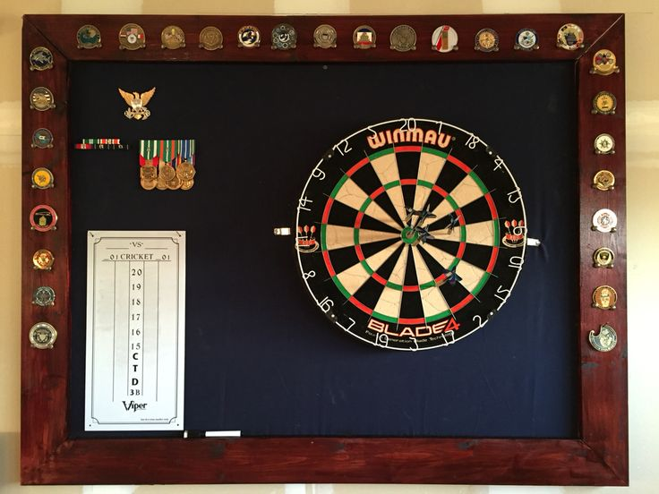 Dartboard backboard displaying my military ribbons, medals, and challenge coins.