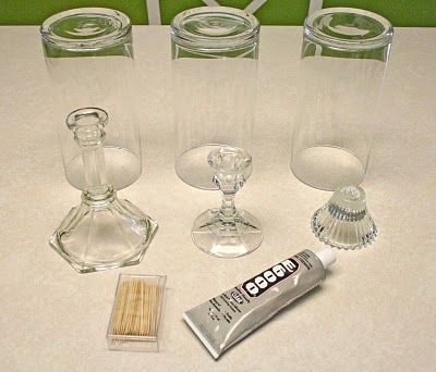 Making cheap hurricanes with dollar store vases, Goodwill candlesticks, and E6000 glue.