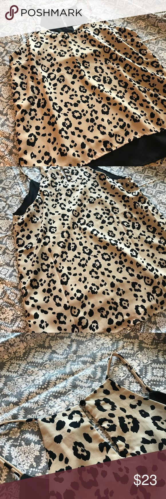 Monteau Leopard Print Black & Tan Tank Top NWOT Super cute and flirty spaghetti strap tank top! Black bottom layer, with a tan and black leopard print design across the top layer. Never worn, brand new without tags! Monteau Tops Tank Tops