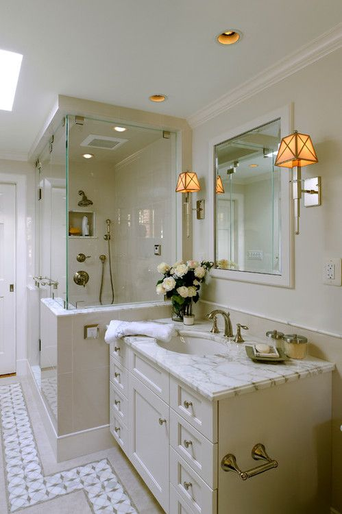 Exquisite bathroom features cream vanity with white marble countertop  paired with white framed mirror flanked by Waterworks Fairfax Single Arm  Sconce Light  141 best Bathroom Vanities   Cabinetry images on Pinterest  . Bathroom Cabinets Vanities Surrey. Home Design Ideas