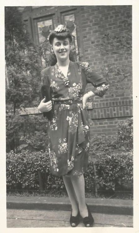 1940s found photo street fashion women in floral rayon dress purse hair rolled style vintage fashion day wear War Era WWII shoes pumps heels accessories flowers