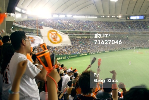 High-Res Stock Photography: Yomiuri Giants baseball fans going wild Tokyo…