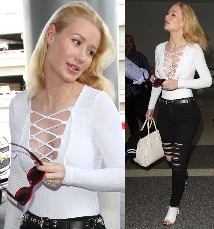Iggy Azalea Goes Braless in Missguided Lace-Up Front Bodysuit and White Mules at LAX