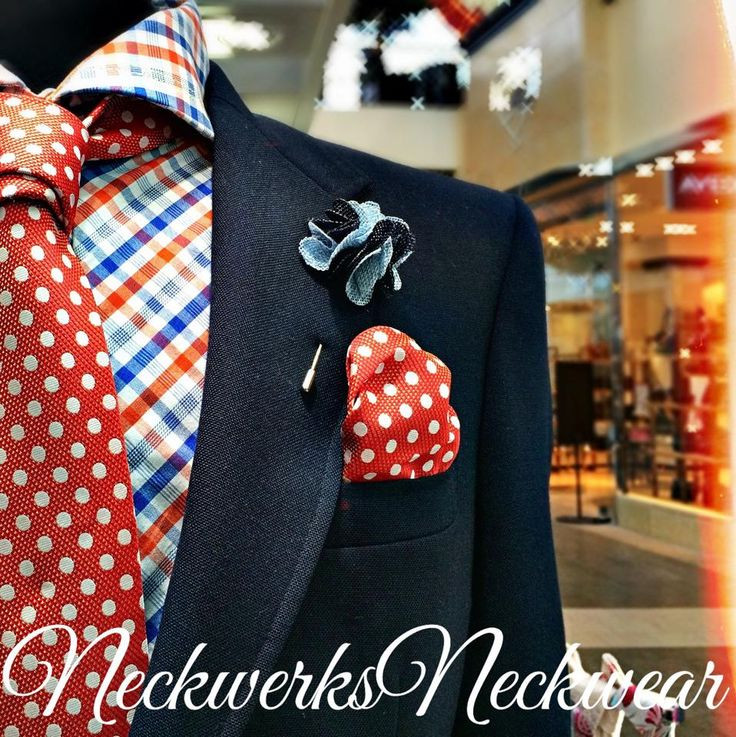 Navy Suit, Orange Polka Dot Tie  made to stand out