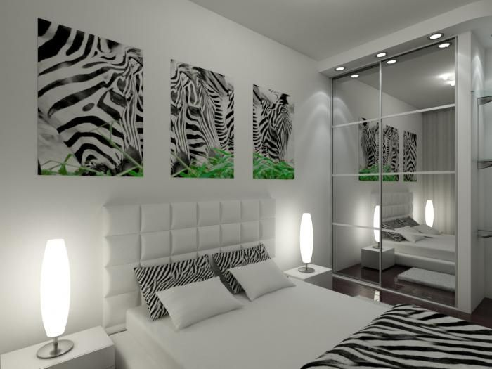 Интерьер черно-белой спальни, декор спальни, постеры и черно-белое покрывало зебра
