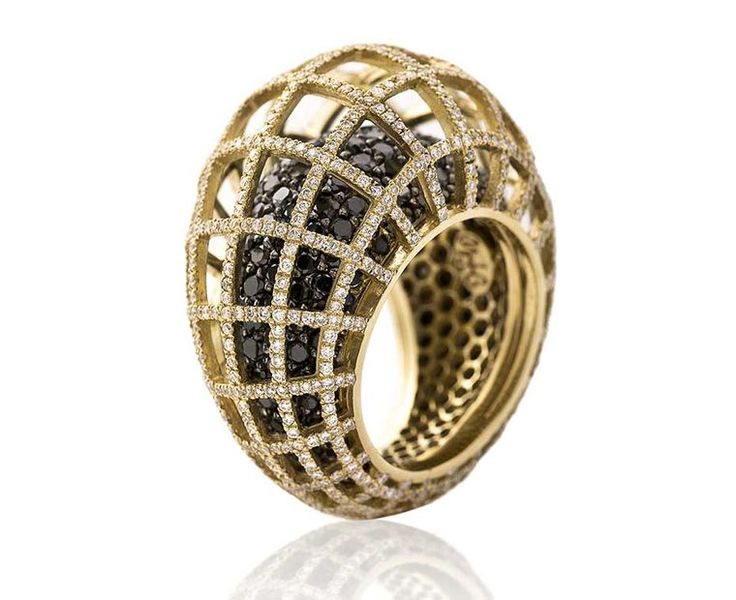Nada G's three-dimensional Matrix Double ring in yellow gold with black and white diamonds at the Couture Show Las Vegas