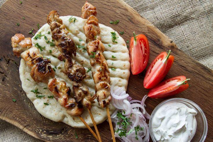 Greek chicken souvlaki by greek chef Akis. Make your own homemade chicken skewers with fluffy pita bread and creamy yogurt sauce!