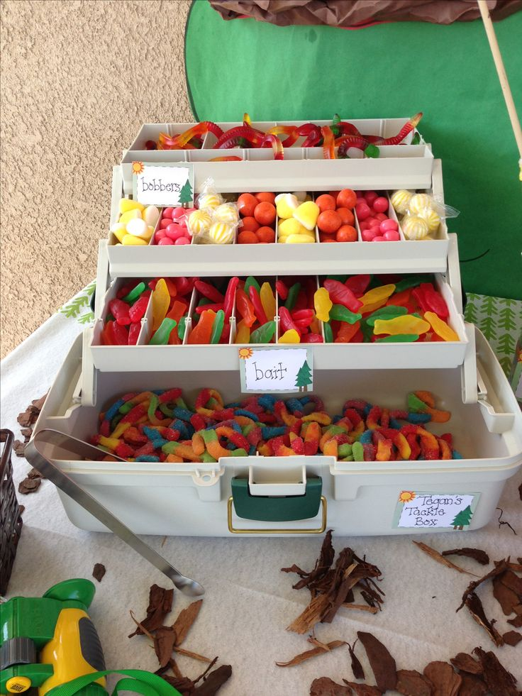 Adorable way to serve sweets at a fishing party! Gummy worms, gummy fish, etc. So cute!