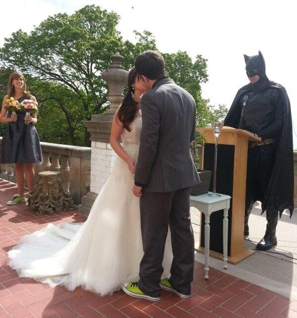 Why not have Batman officiate? I'm loving the shoes the groom and bridesmaid are wearing, too. Nice touch (and way less expensive, I reckon)!