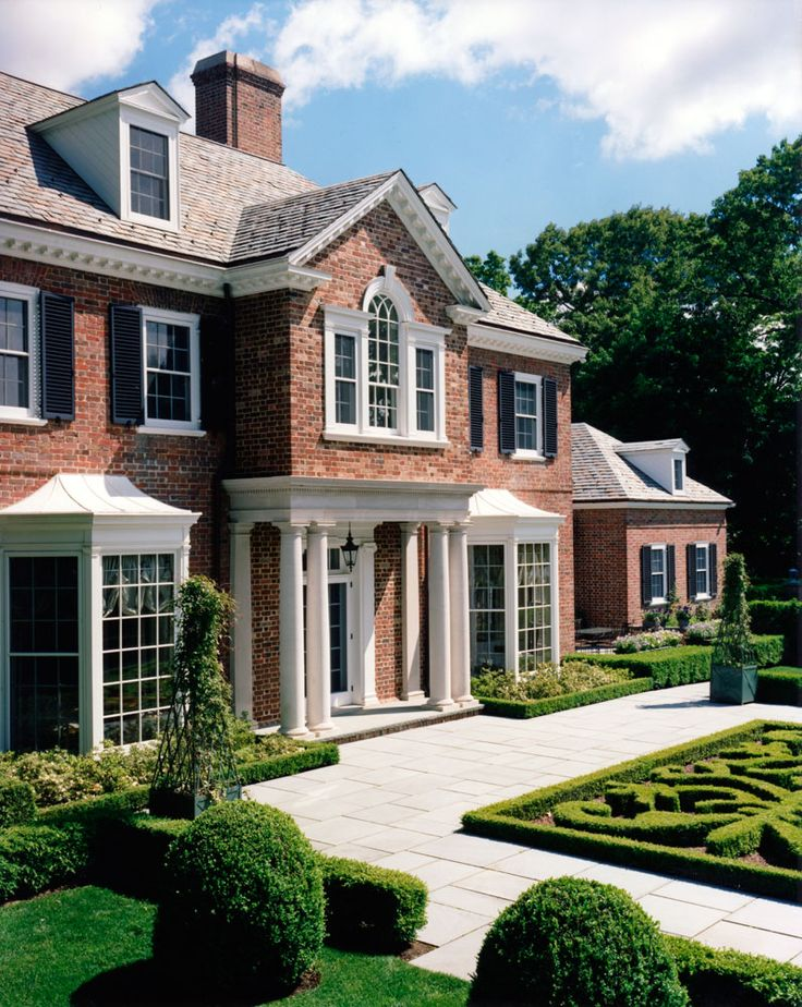 Charles Hilton Architects   American Brick Georgian Portico Entry with Formal French-Style Landscaping