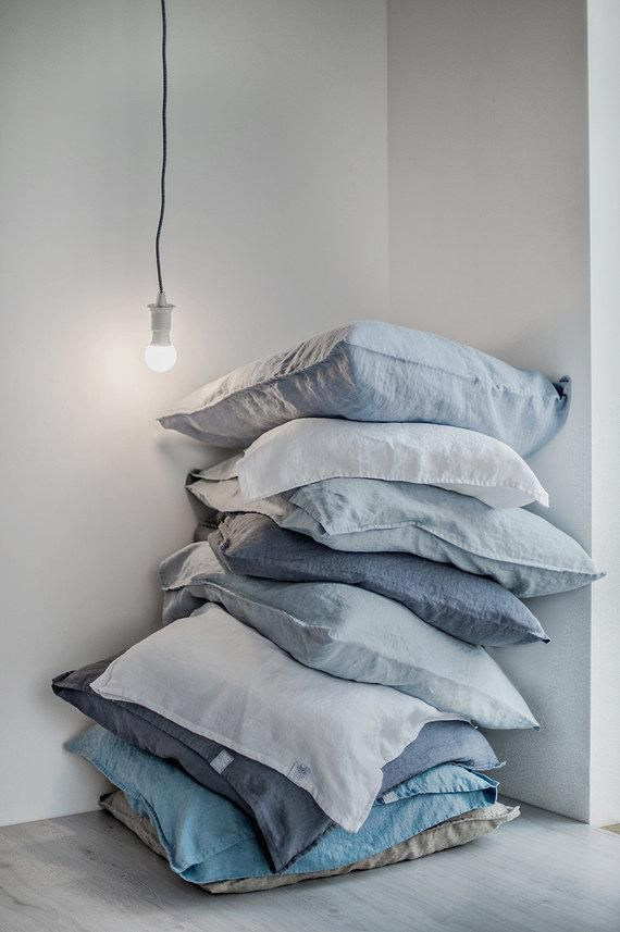 We'd like to drift off to dreamland atop a fluffy pile of pillows in cloud-colored linen cases. #etsy