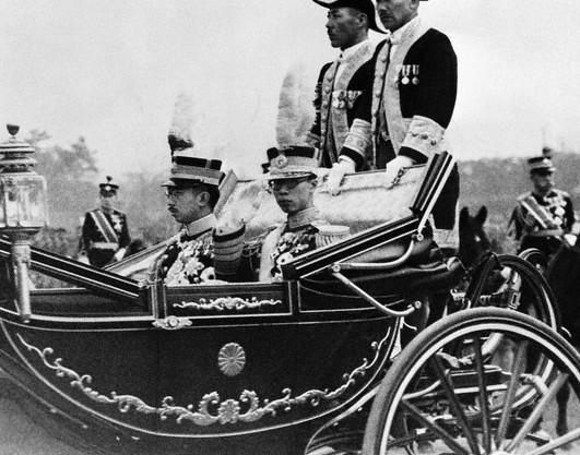 Emperor Hirohito of Japan and Emperor Kangde of the Japanese puppet state Manchukuo, 1935