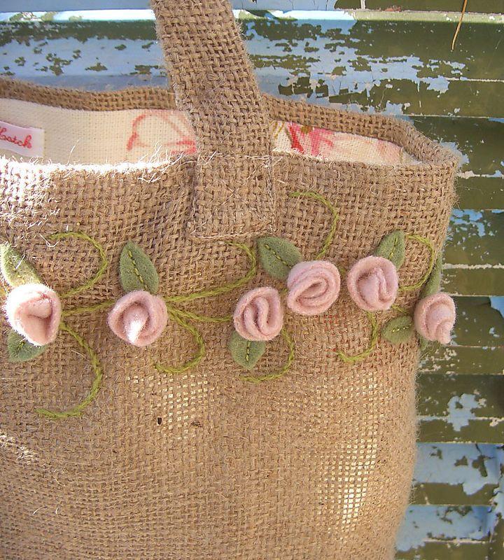 pink felt rosebuds on simple fabric lined bag....tutorial for rosebuds on site