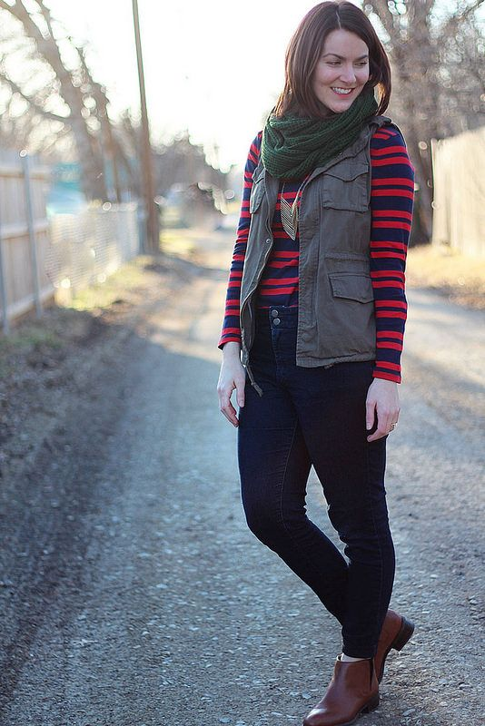 jeans, utility vest, red and blue stripe shirt