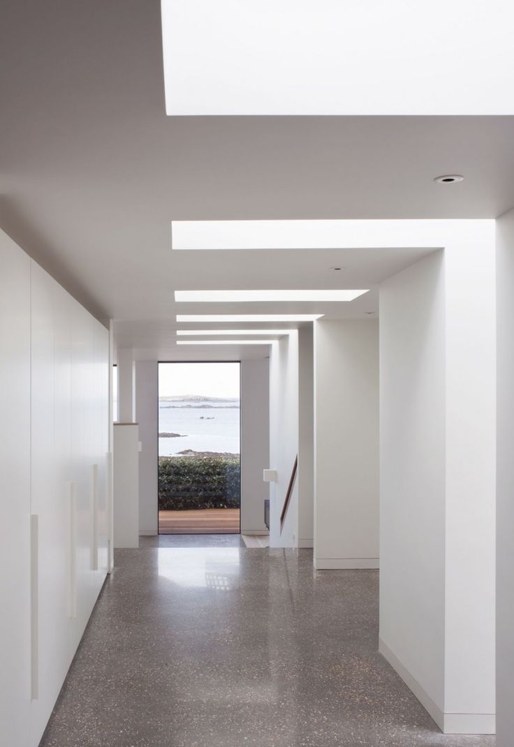 Portelet House by MOOARC, floor, build in storage solutions, window, view, hallway, simplicity, miminalistic, modern interior design style