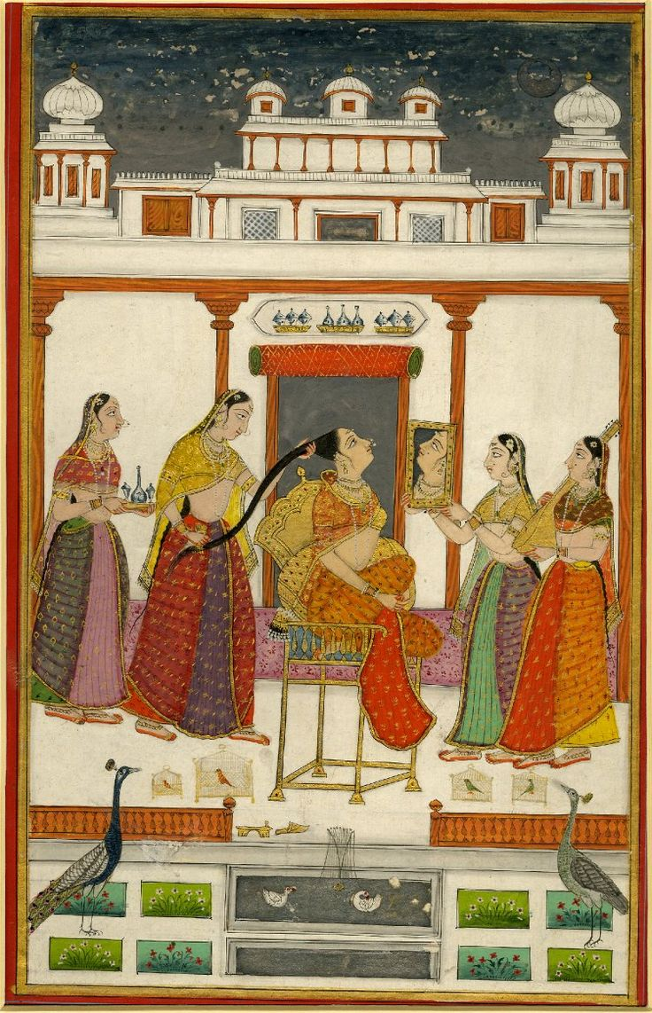 Vilaval Ragini from a dispersed Ragamala set. A woman looking in a mirror, surrounded by attendants. Date 1740. Painted in: Deccan