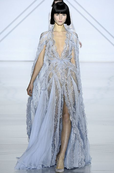 Ruffles, lace, and sheer romance was the protocol for this ethereal Ralph&Russo gown.
