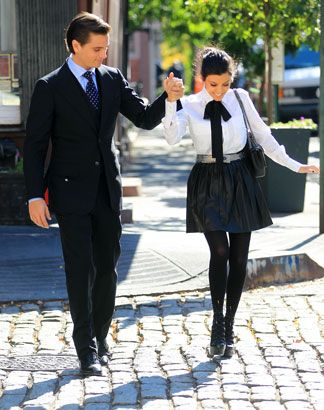not her biggest fan, but loveeee the menswear outfit. the blouse is fabulous with that bow.