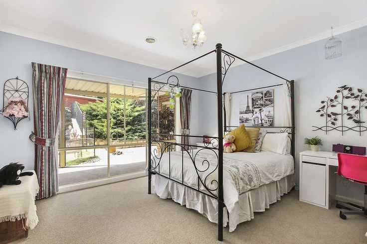 A light and airy room which looks out over the pool area and the fruit trees..... This room is a great size and features a walk in robe and a spacious ensuite.