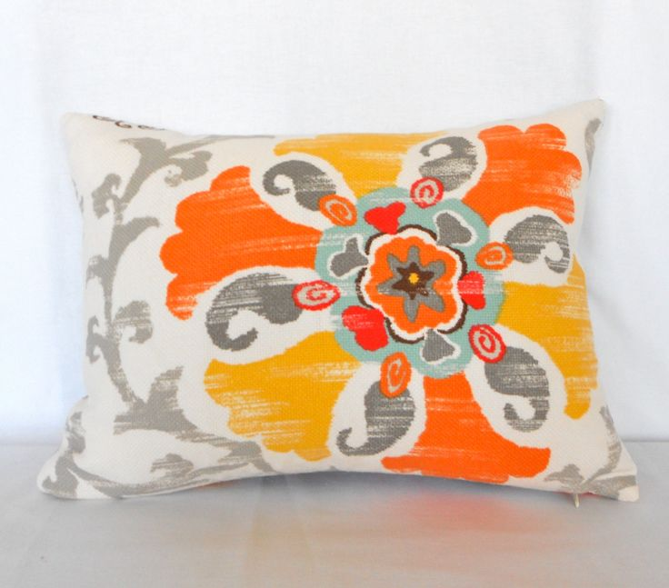 Yellow, orange, blue, grey pillow