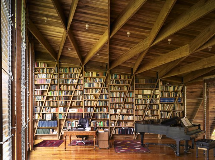 A writer's delight - Lots of books, light, a piano and a nice workspace. From a writer's house in Costa Rica | #InteriorDesign |
