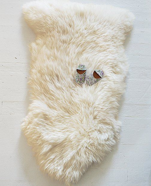 Lambskin rug by #hannahome | #sunnydaygiveaway Would be better in faux fur though...