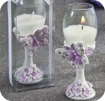 Butterfly Flute Candle Favors - party favors. great, cute decoration maybe as center pieces, its a subtle decoration that won't stand out more than the Quines girl ;)