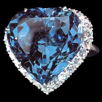 The Blue Heart Diamond set in a platinum ring, surrounded by 25 white diamonds. It weighs 30.82 carats