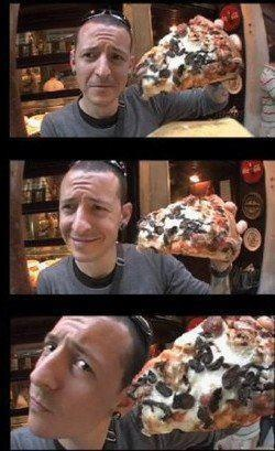 chester bennington of linkin park.  that is a BIG fucking piece of pizza dude!