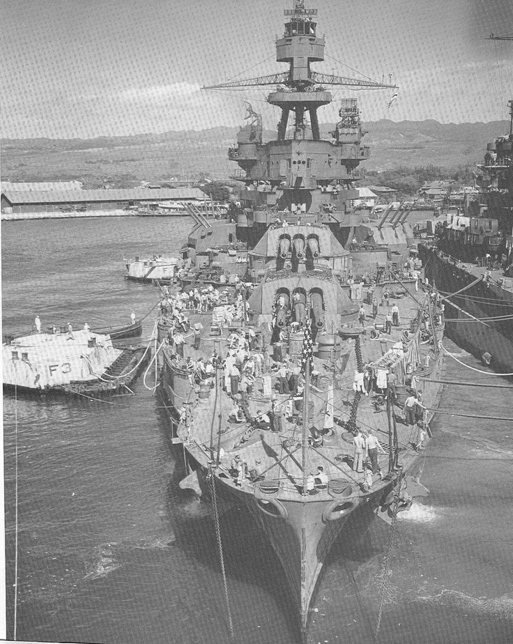 Battleship USS Pennsylvania BB38 tied up next to USS Colorado BB45 on or about December 7, 1943 at Pearl Harbor, Hawaii.  This is 2 years after the attack on the base in which Pennsylvania was one of the many damaged battleships.  See the many changes to the ship since that time.