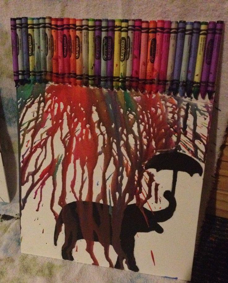 Melted crayon art elephant holding umbrella